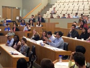 Professor Pranab Majumder asks a question after a presentation by Duke MMS Students in the Accenture Case Competition