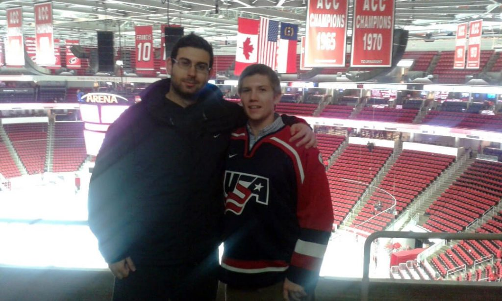 Students at a hockey game at PNC Arena