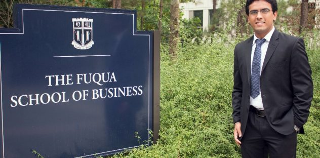 Sahil beside Fuqua's sign as he begins his master of management degree at Duke