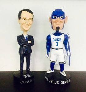 A Coach K bobblehead and a Blue Devil bobblehead, sporting events at Duke
