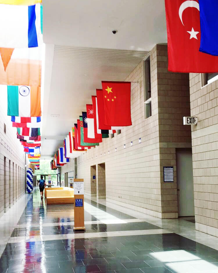 Dozens of country's flags line the hall, questions to ask when considering graduate school
