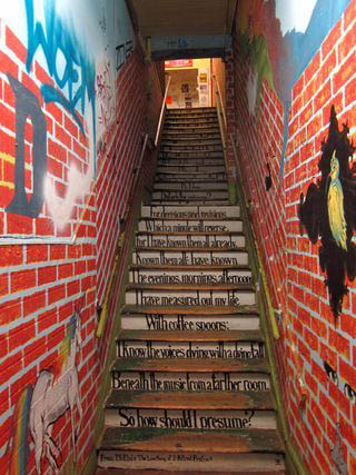 the colorful, graffiti lined stairwell that leads to Cosmic Cantina, one of the best restaurants in Durham