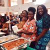students, some of whom are dressed in traditional African garments, enjoying Nigerian food at the event, MMS is a special program