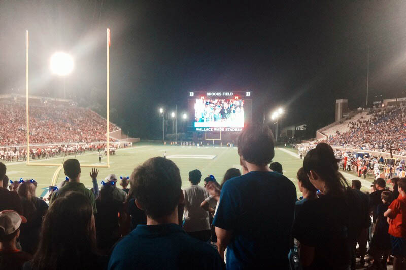 thousands of students attending an evening Duke football game at Wallace Wade Stadium, MMS is a special program