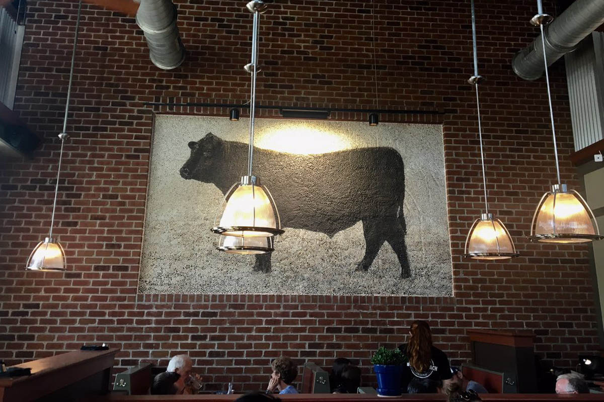 a cow mural in the dining room, explore Durham