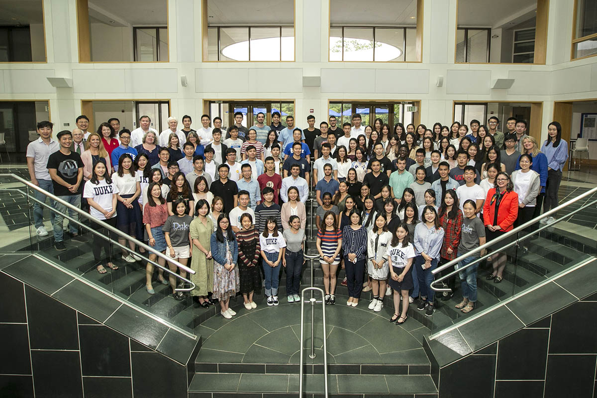 approximately 100 students and staff pose for a group photo during International Student Bootcamp