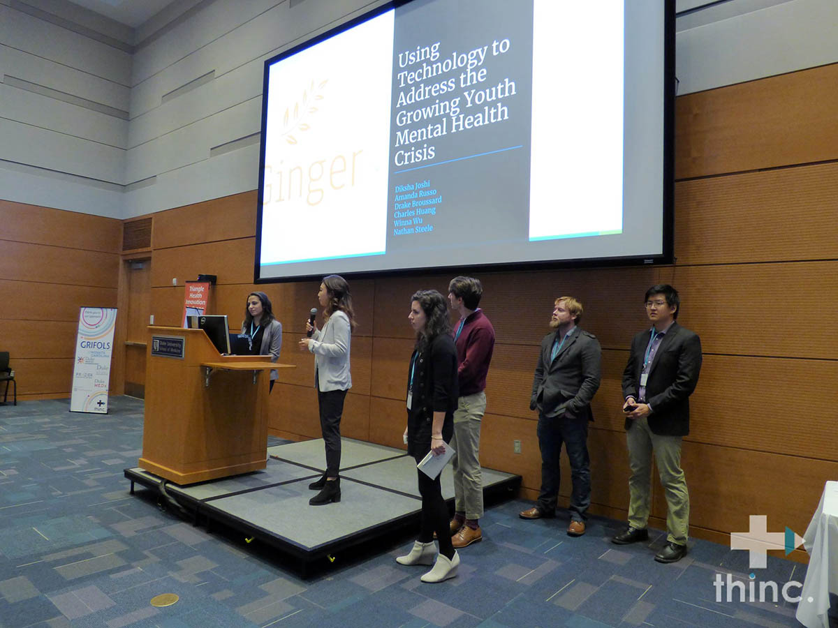 Winna presenting with her team at the Triangle Health Innovation Challenge; nursing and business
