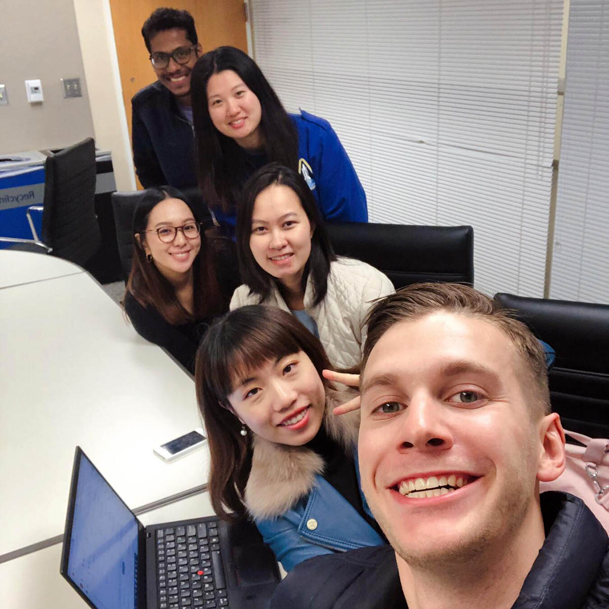 6 students on Janet's Duke Interdisciplinary Social Innovators team pose for a photo in a team study room