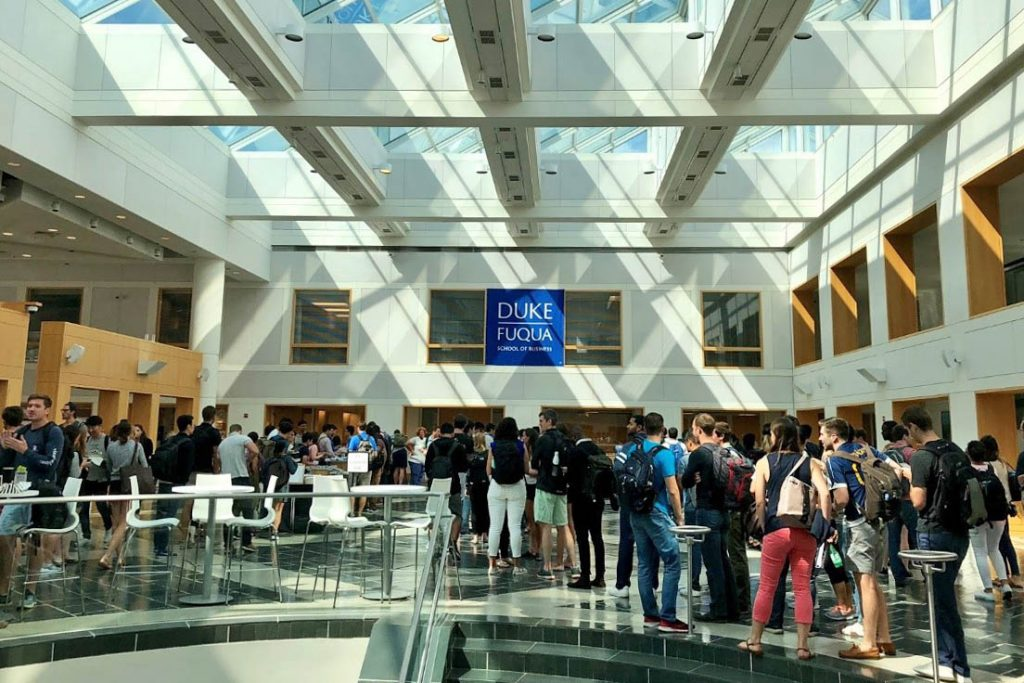 dozens of students gathered in Fuqua's Fox Center at one of their student events