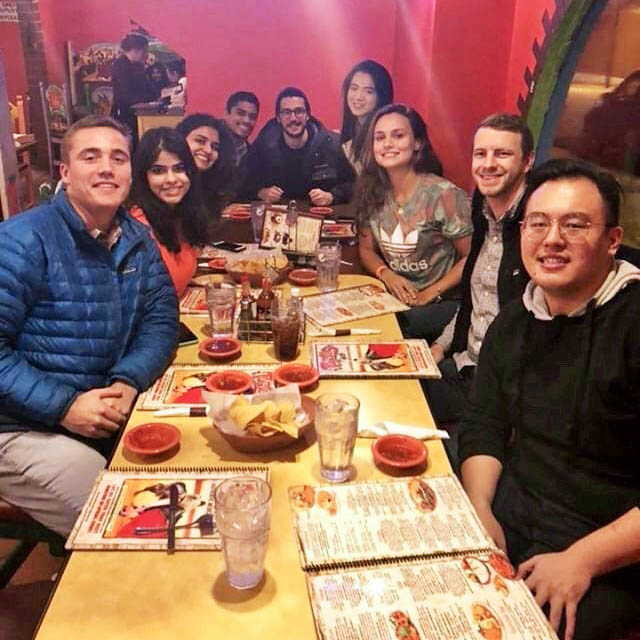 9 students around a table at a Mexican restaurant, one of the student events
