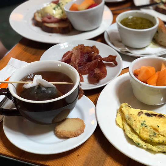tea, bacon, an omelet, fruit and more at Guglhupf, one of Lily's brunch recommendations
