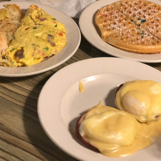an omelet, waffle and eggs Benedict from Ye Olde Waffle Shoppe, one of Lily's brunch recommendations