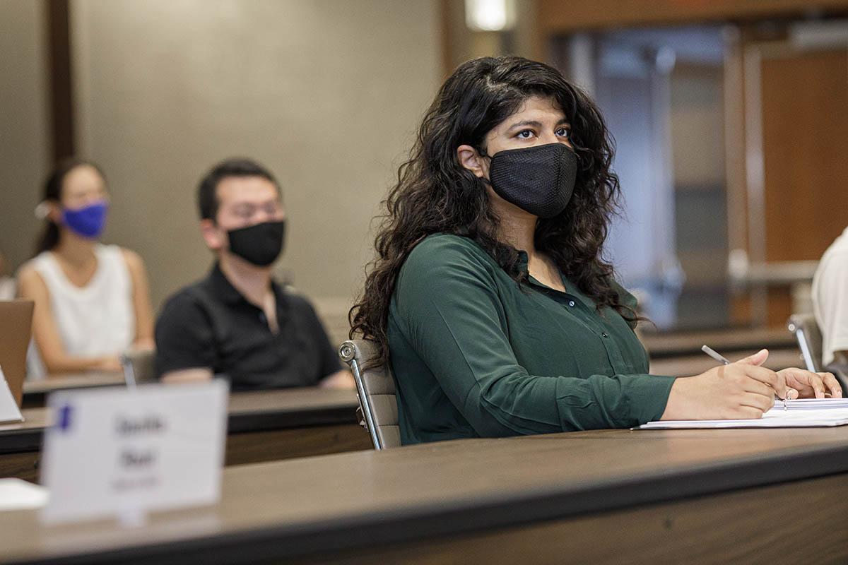 Fuqua Student Wearing a Mask in a Classroom Setting; MMS Graduates Jobs