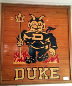 A vintage blue devil logo on display at the Washington Duke Inn