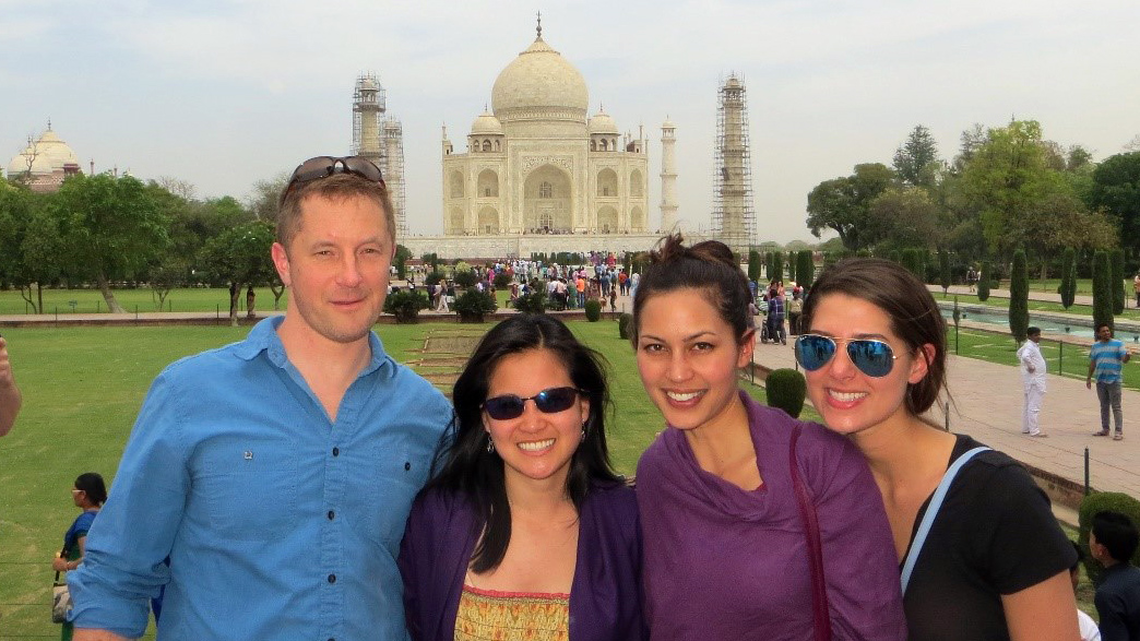 four classmates standing in front of the Taj Mahal provide a great representation of diversity at Fuqua