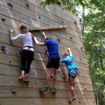 3 Cross Continent students climbing a wall during MBA Orientation