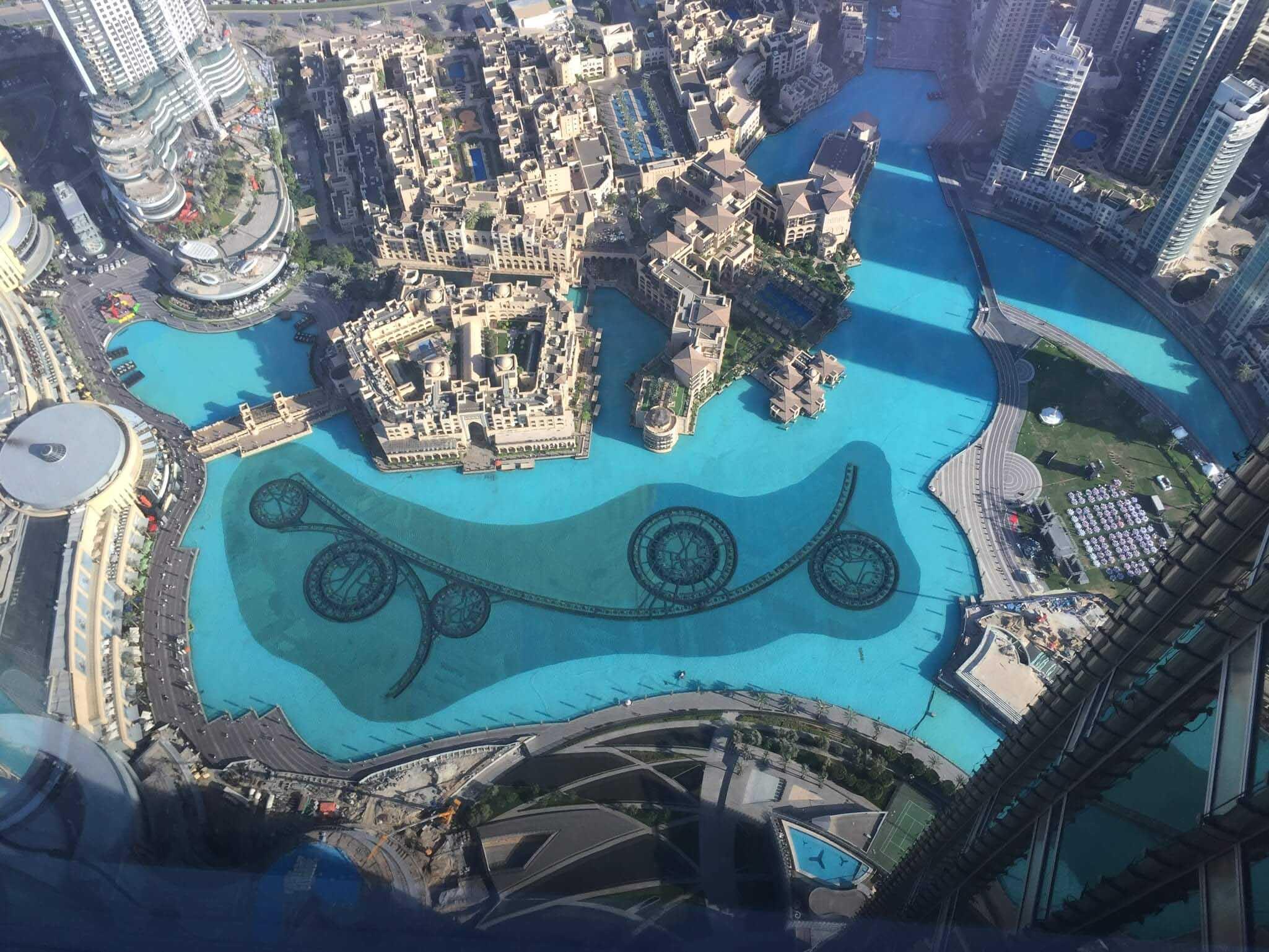 aerial view looking downward on buildings and water in Dubai