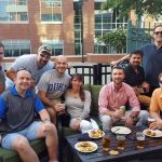 your MBA cohort makes everything click...classmates having dinner and beers on a patio