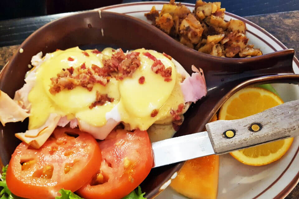 an eggs Benedict plate from Brigs in the Park, a great spot for brunch in Durham