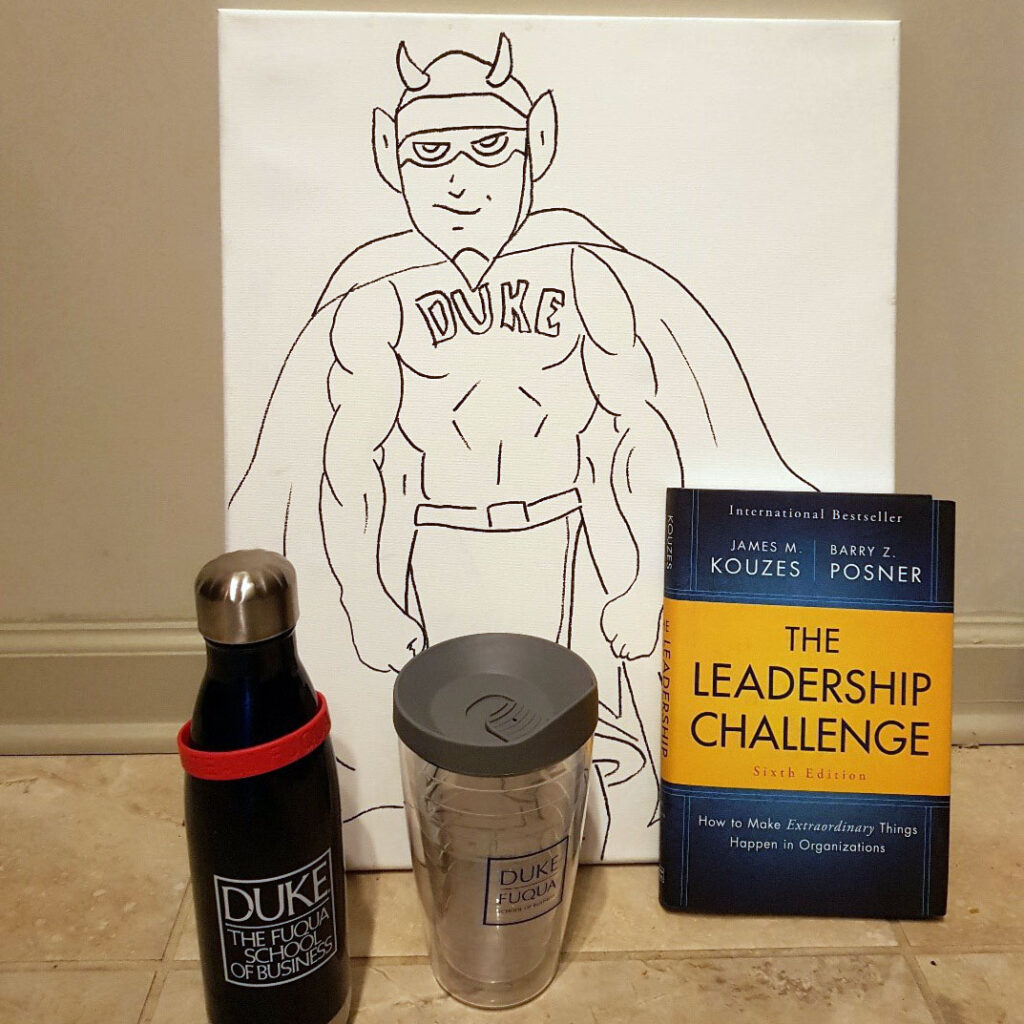 """a blue devil painting, water bottle, cup and the book """"The Leadership Challenge"""" ... Fuqua is transforming me into a better person"""