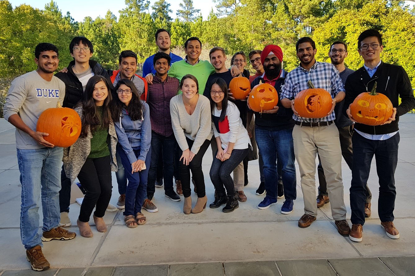 students displaying their freshly carved Halloween pumpkins, Fuqua is transforming me into a better person