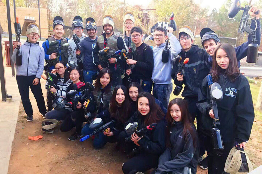 group shot of students ready to play paintball, one of the fun extracurricular activities