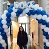 Standing beneath a Duke balloon sign at Fuqua, Marketing Club