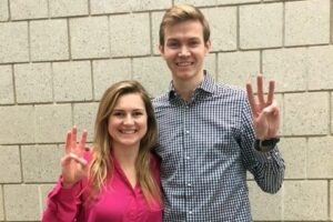 The hackathon experience...Kelsey and Collin holding up the number 3 on their hands after the Duke Men's Basketball Hackathon