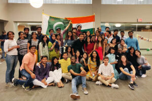 dozens of students pose with the flags of India and Pakistan, one of the events that made the author feel welcomed by Fuqua