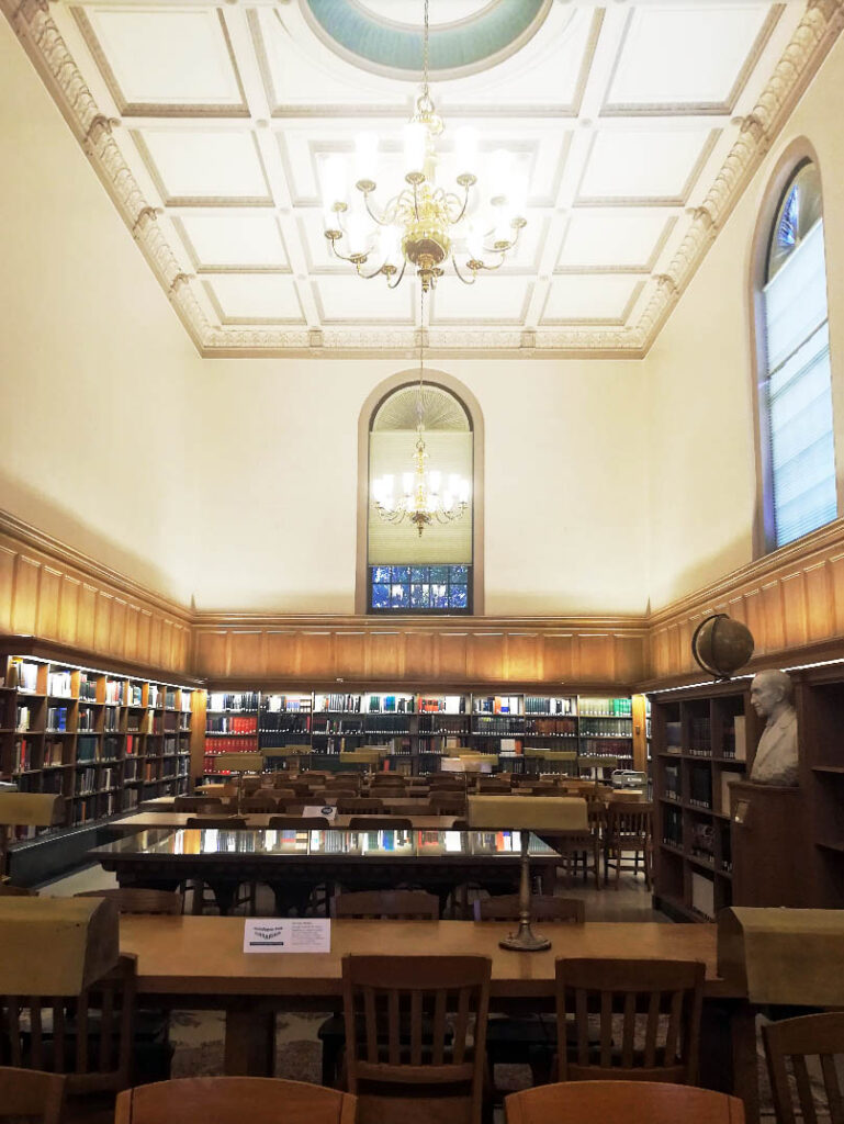 a tables and walls filled with books inside Lilly Library, one of Rohma's favorite study spots