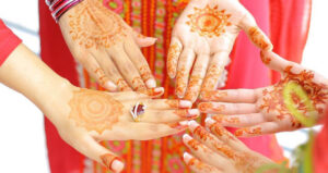 five hands with henna art together forming a circle, symbolizing family at Fuqua