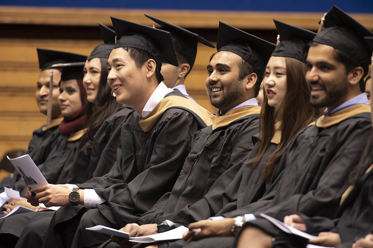 students seated and smiling during their graduation commencement; Class of 2019 jobs report
