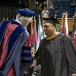 Dean Boulding congratuling student at graduation