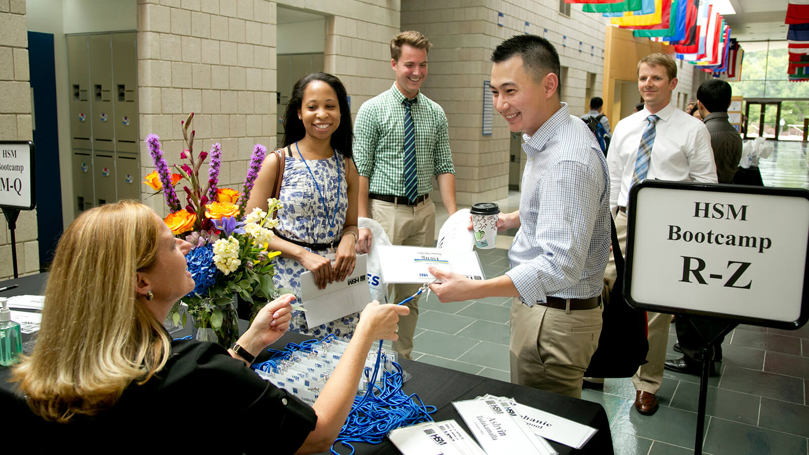 Students register for HSM Bootcamp, a health care management course taught to Duke MBA students at Fuqua