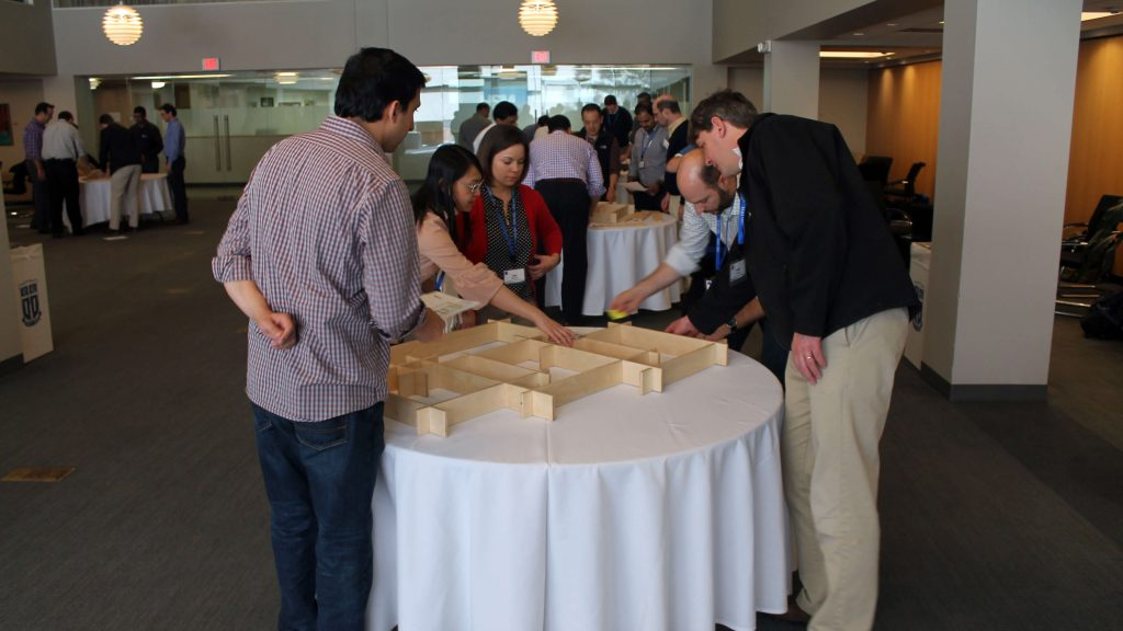 students teams building puzzles, MBA experience