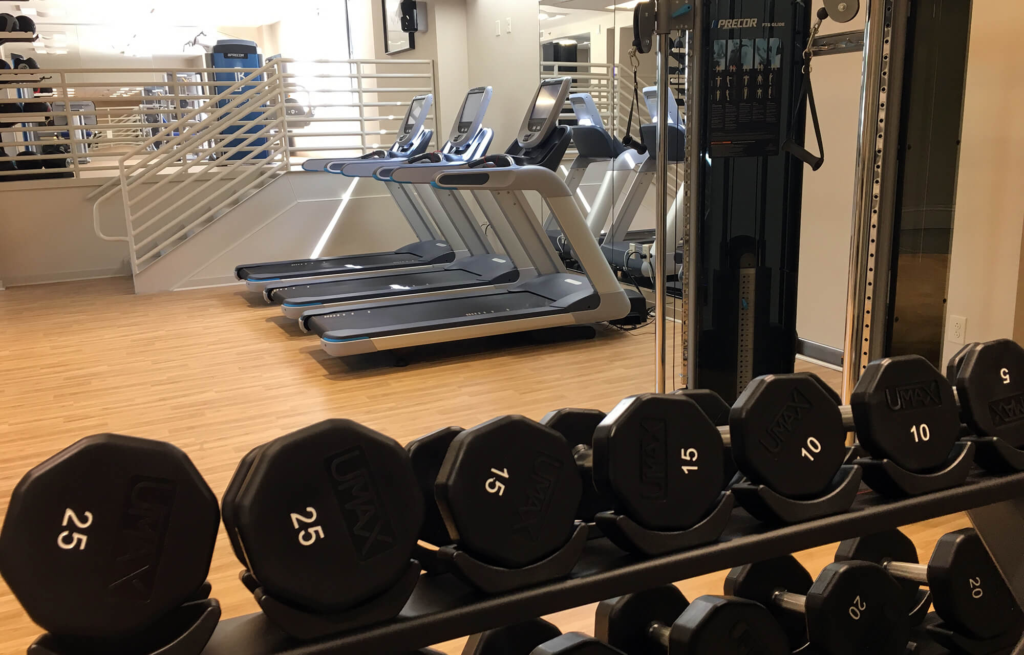free weights and treadmills in the JB Duke Hotel fitness room, used by Run Fuqua