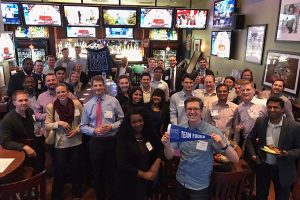 dozens of alumni, students, and admits gather at a bar for Fuqua Around the World,