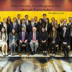 more than a dozen Duke students in a group photo taken while meeting Warren Buffett