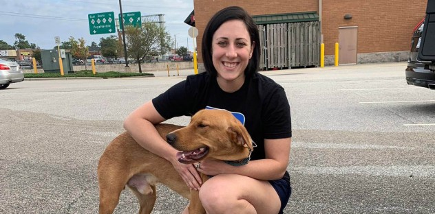 Marina with a dog during a hurricane relief supply run to Walgreen's