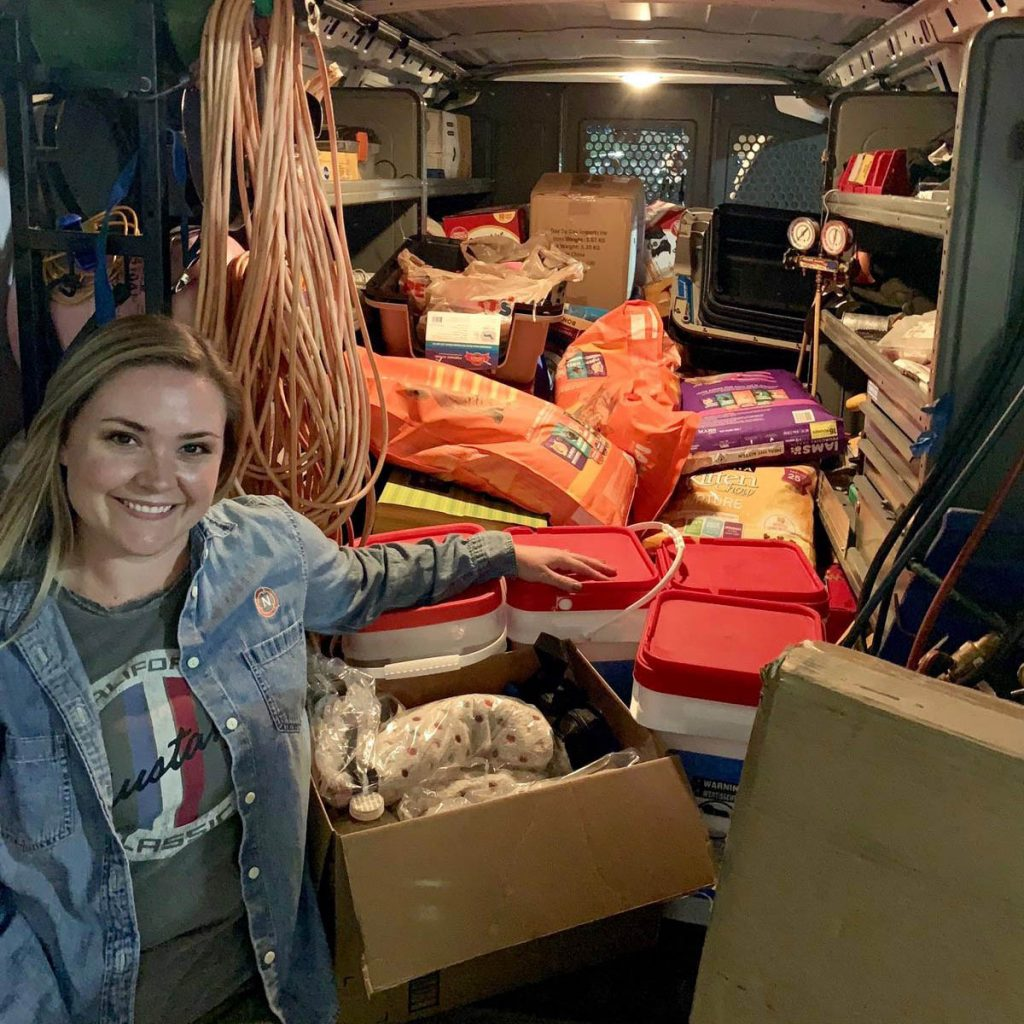 Shawna with a van full of hurricane relief pet supplies ready for delivery
