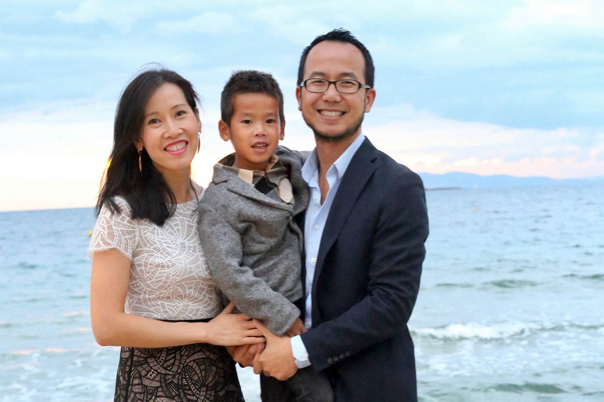 Jenny's family: she, her son and her husband post for a photo on the beach