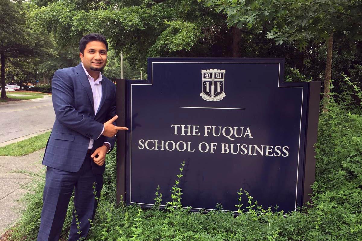 Preshank posing beside the Fuqua sign; MBA reflections