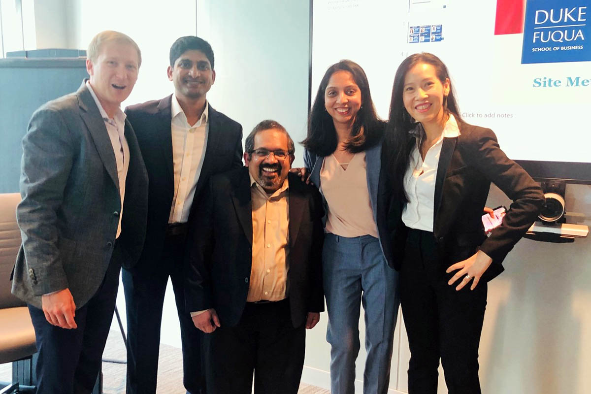 Five members of the consulting team posing for a group photo