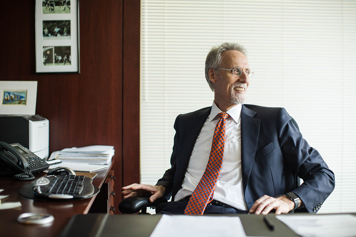 Dean Bill Boulding seated in his office; Fuqua's culture