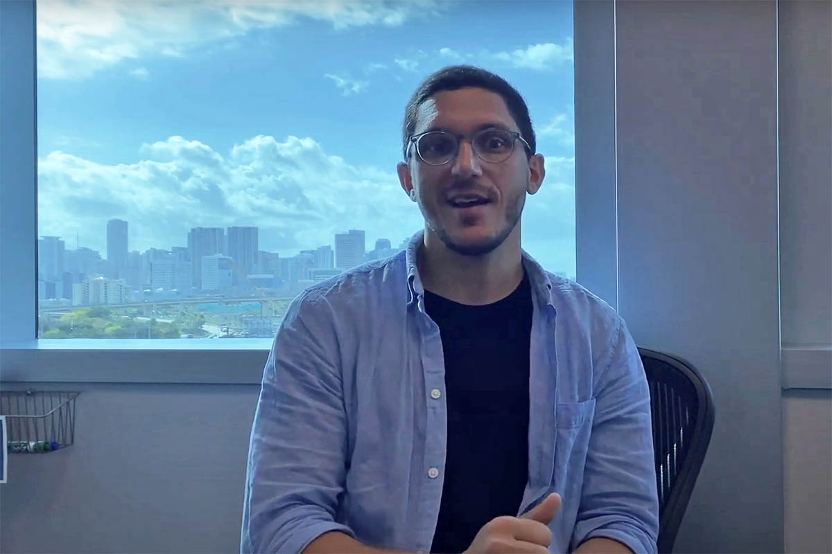 A screenshot from Manu's video below where he talks about his alumni impact