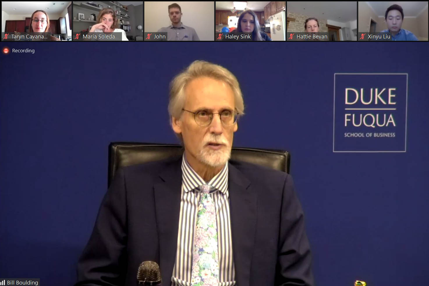 A screenshot with several students and staff watching Dean Bill Boulding; completing my degree online