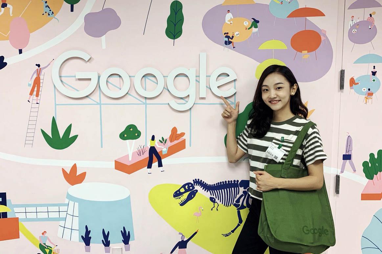 Rachel standing in front of the LinkedIn sign, exploring West Coast jobs